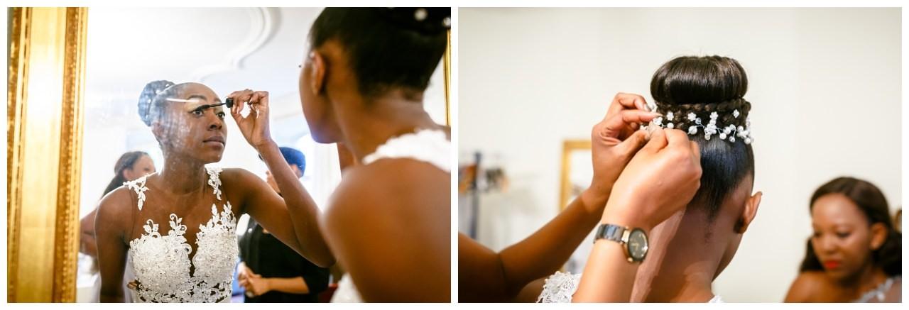 Die Brautfrisur bekommt Perlen angesteckt.
