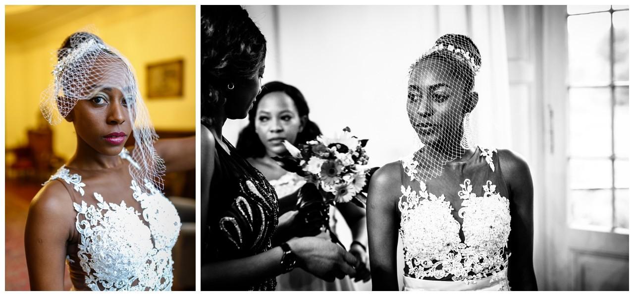Die Braut hat einen kleinen Netzschleier vor dem Gesicht.