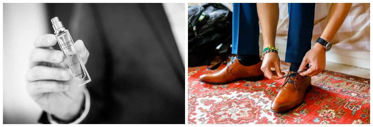 Der bräutigam zieht sich die Schuhe an.