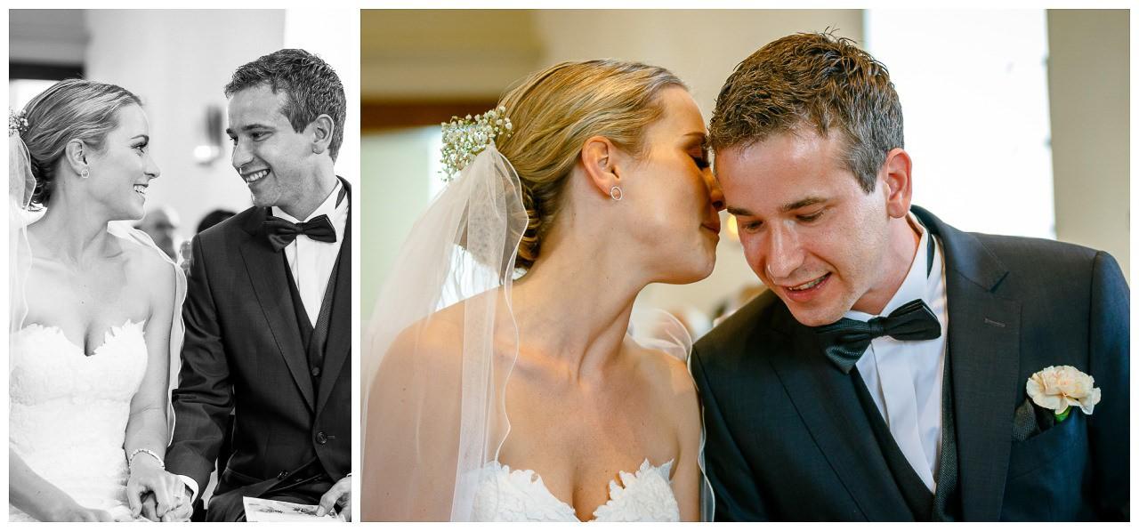 Kirchliche Trauung Velbert, die Braut flüstert dem Bräutigam etwas ins Ohr.