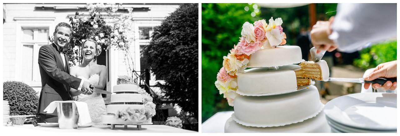 Hochzeitstorte echte Blumen, das Brautpaar schneidet die Torte an.