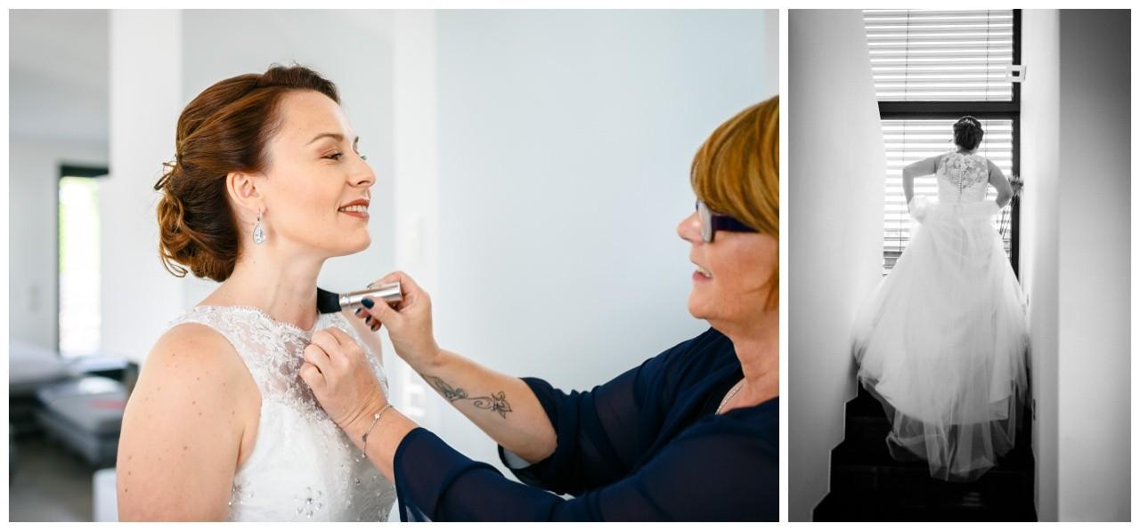 Freie Trauung in der Wipperaue in Solingen die Trauzeugin hilft der Braut beim Getting Ready vor der Hochzeit