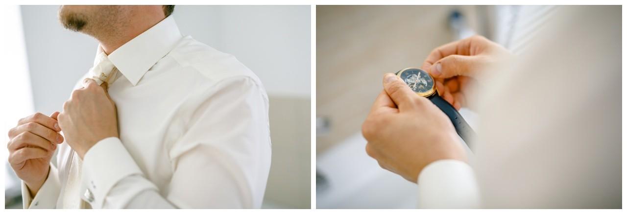Getting Ready vor der Hochzeit im Ruhrgebiet der Bräutigam zieht seinen Plastron an