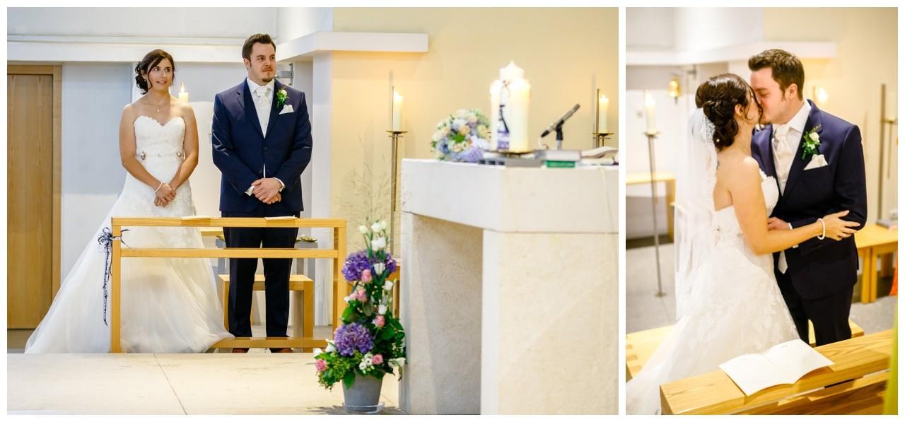 Hochzeit im Ruhrpott das Brautpaar gibt sich bei der kirchlichen Trauung den Hochzeitskuss
