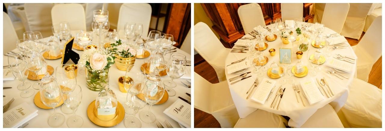 Hochzeitsdekoration in Gold und weiß